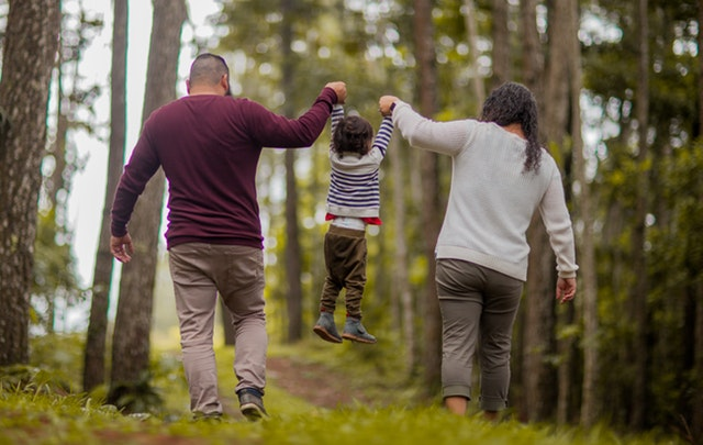 man-and-woman-carrying-toddler-3038369